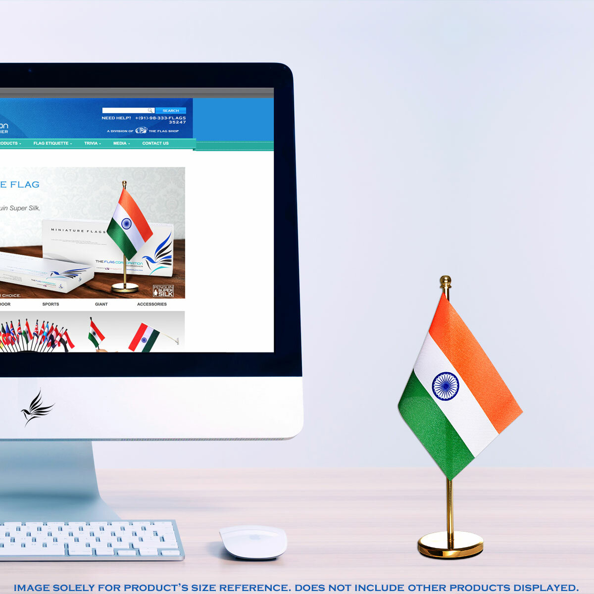 Indian National Flag With A Gold Brass Stand Next to Computer