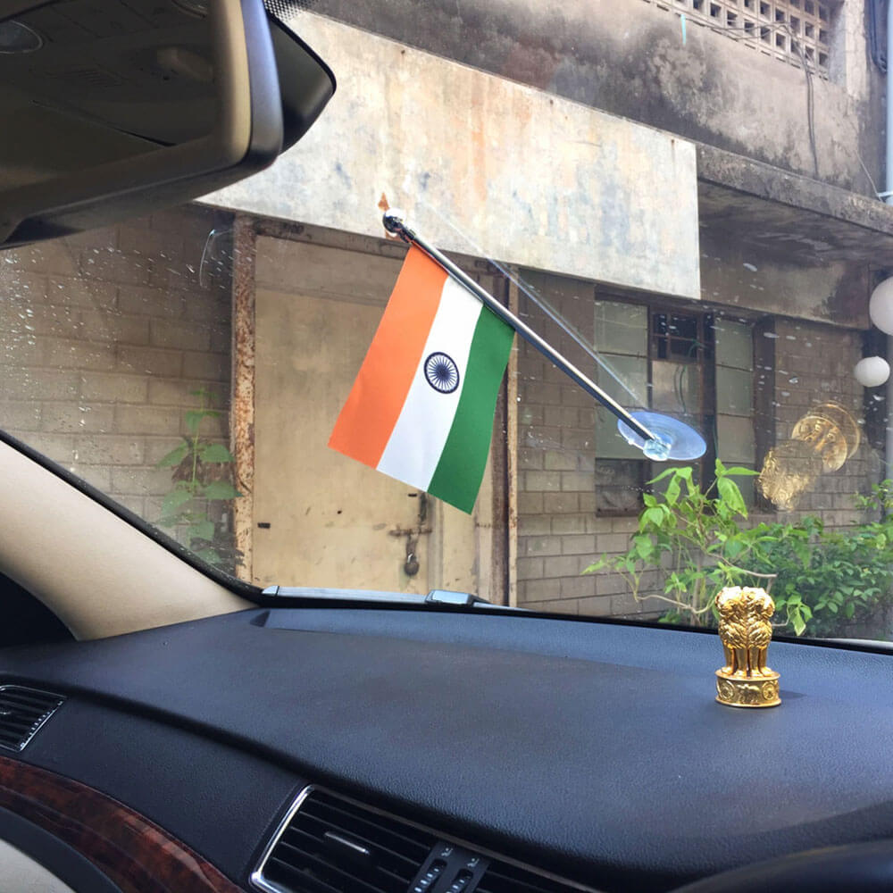 indian flag with a chrome plated staff with a vacuum suction stand for displaying on the cars windshield