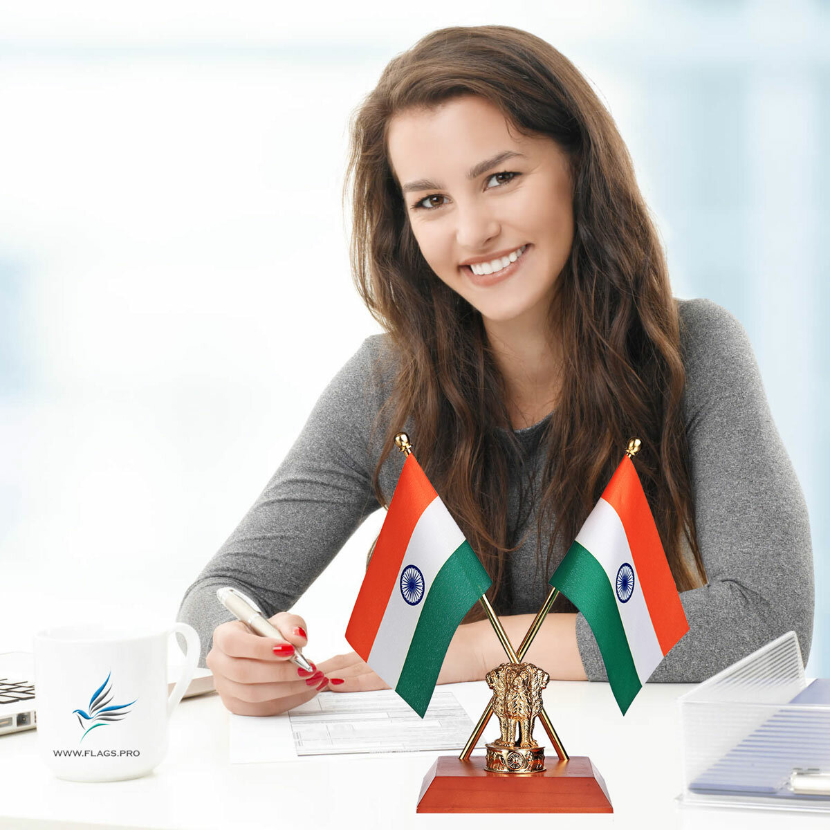 Girl On Office Desk With a Cross Indian Table Flags Set, With Our Exclusive Gold Plated Brass Ashok Stambh on A Polished Wooden Base