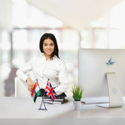 girl sitting at office desk with an indian and uk cross flag chrome plated plastic stand