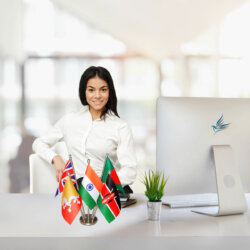 girl sitting at office desk with indian flag & other national flags together on a stainless steel stand