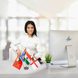 girl sitting at office desk with indian flag & indian armed forces flags of the army, navy & air force