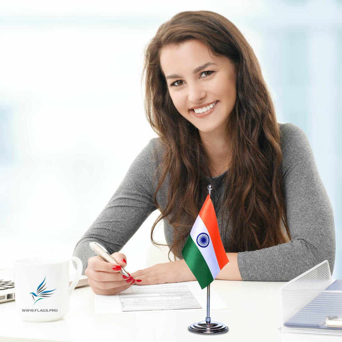 girl sitting at office desk with an indian table flag with a chrome plated plastic stand
