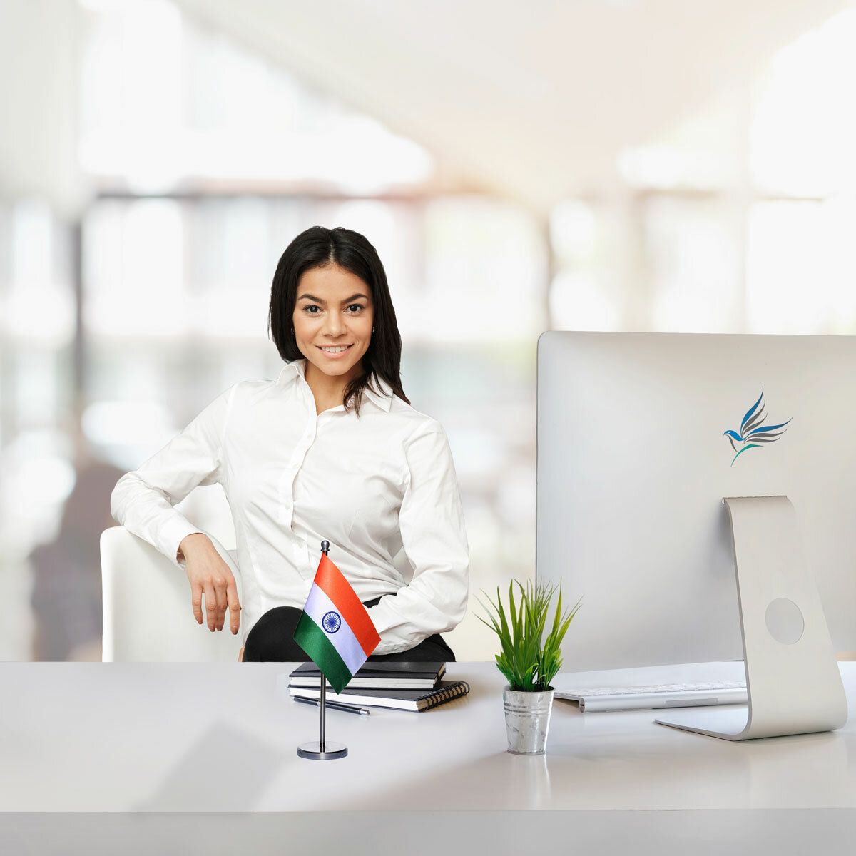 girl sitting at office desk with an indian table flag with a stainless steel stand